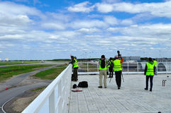 Spotting fans take  picture of planes on the territory of Pulkovo International airport in Saint-Petersburg, Russia Stock Photo
