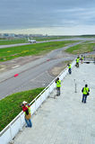 Spotting fans take  picture of planes on the territory of Pulkovo International airport in Saint-Petersburg, Russia Stock Photos