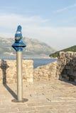 Spotting scope pipe on the beach in Budva Royalty Free Stock Photos