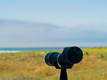 Spotting Scope Pointing to the Beach Stock Image