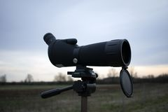 Spotting scope on a tripod in nature stock image