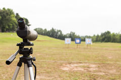 Spotting scope on tripod at outdoor archery target range Royalty Free Stock Photography