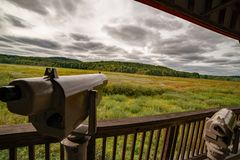 Spotting scopes at wildlife observatory overlooking migratory bird and wildlife habitat in the national wildlife refuge. Spotting scopes at wildlife observatory royalty free stock image
