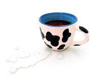 Spotty CUP with black coffee. On white near drop of milk Stock Photos