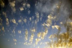 Spotty luscious clouds wide angle top. The Spotty luscious clouds wide angle top royalty free stock image