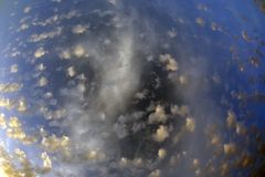 Spotty luscious clouds wide angle top. The Spotty luscious clouds wide angle top stock photography