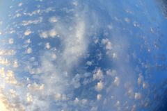 Spotty luscious clouds wide angle top. The Spotty luscious clouds wide angle top stock photo