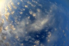 Spotty luscious clouds wide angle top. The Spotty luscious clouds wide angle top royalty free stock photos