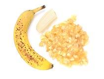 Spotty, overripe banana with mashed fruit Royalty Free Stock Image