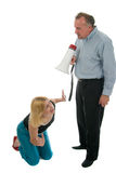 Spousal Abuse Humor 4. Extreme domestic argument with husband shouting commands through a megaphone at his fearful wife Stock Image