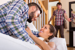 Spouse coming home and saw unfaithful woman Royalty Free Stock Images
