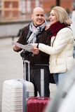 Spouses with baggage and map Royalty Free Stock Photos