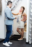 Spouses at boutique changing cubicle Royalty Free Stock Photos