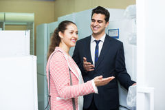 Spouses buying domestic refrigerator Royalty Free Stock Image