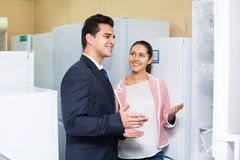 Spouses buying domestic refrigerator Royalty Free Stock Photo