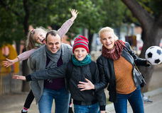 Spouses with children posing in autumn park Royalty Free Stock Photography
