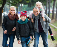 Spouses with children posing in autumn park Royalty Free Stock Images