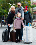 Spouses with children shooting mutual portrait on cell phone. Traveling russian spouses with children shooting mutual portrait on cell phone Royalty Free Stock Image