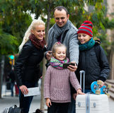 Spouses with children shooting mutual portrait on cell phone. Traveling spanish spouses with children shooting mutual portrait on cell phone Stock Images