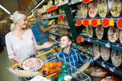 Spouses choosing pizza in store Royalty Free Stock Photography