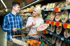 Spouses choosing pizza in store Stock Images
