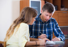 Spouses with documents for bank at home Stock Photo