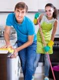 Spouses doing regular housework and polishing Stock Images