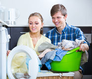 Spouses doing regular laundry Stock Photography