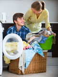 Spouses doing regular laundry Royalty Free Stock Photography