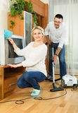 Spouses dusting and hoovering Royalty Free Stock Photo