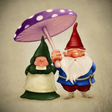 Spouses gnomes. Little spouses gnome under the big fungus Royalty Free Stock Photo