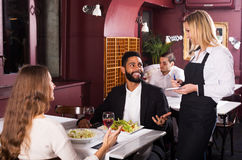 Spouses having date in restaurant Royalty Free Stock Images