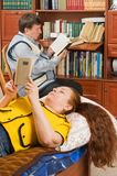 Spouses like to read books. Stock Photo