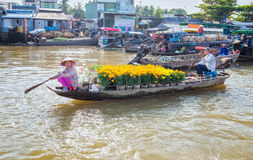 Spouses rowing boat on the river chrysanthemum sale Stock Photography