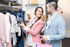 Spouses while shopping at boutique Stock Image