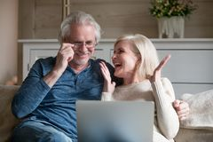 Spouses sitting on couch feels happy received great news online stock photography