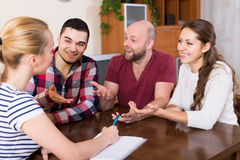 Spouses sitting with documents and asking friends for advice Royalty Free Stock Images