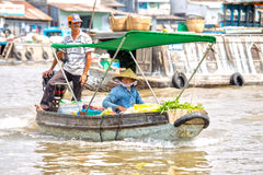 Spouses trade vegetables floating market on the river Royalty Free Stock Image