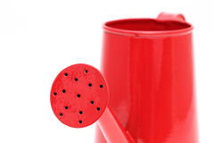 Spout of red watering can Royalty Free Stock Photos