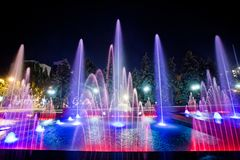Spouting fountain illumination in front of City Hall, Donetsk 2012 view 6. Spouting fountain with colorful illumination at night, shot in Donetsk on Artema royalty free stock photography