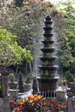 Spouting Fountain with sparkling drops in Bali water palace gard Stock Photo