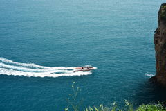 Spped boat in torquise sea. Speed boat approaching a cave,lara , turkey Royalty Free Stock Images