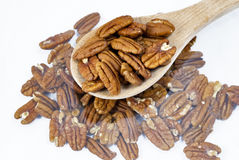 Sppon of Pecans on table Stock Image