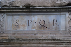 SPQR. Is an initialism from a Latin phrase, Senatus Populusque Romanus (The Senate and People of Rome, see translation), referring to the government of the Royalty Free Stock Photography