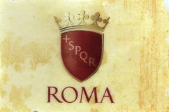 Spqr ancient Rome motto on a marble tile. Spqr ancient Rome motto writing on a marble tile Royalty Free Stock Photo
