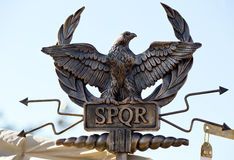 SPQR eagle scepter. Scepter with an eagle and the letters SPQR (Senatus Populus Romanus). Icon government of ancient Rome Stock Image
