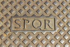 SPQR on street manhole cover. ROME – AUGUST 29: SPQR on street manhole cover on August 29, 2016 in Rome Royalty Free Stock Images
