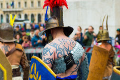 Spqr tattoo on man dressed as roman soldier during a march in rome. Man with tattoo during a  historic march in rome Stock Images