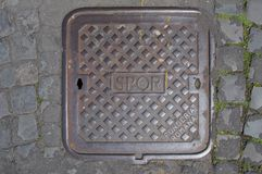 SPQR, typical manhole cover in Rome, Italy. SPQR abbreviation on a typical manhole cover in Rome, Italy Royalty Free Stock Photos
