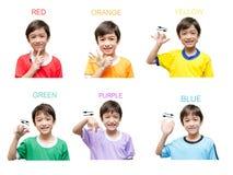 Språk för tecken för färgungehand fotografering för bildbyråer